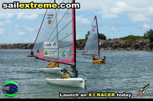 X3-sailing-dinghy-fleet-edge-racing-off-the-beach
