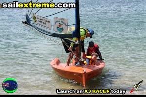 X3-sailing-dinghy-three-up-beach-landing
